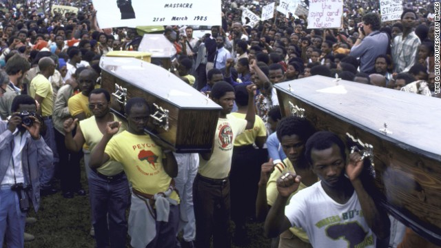 Crowd during funeral with coffins of 29 killed in April 1985 unrest in South Africa.