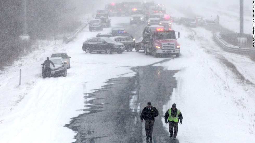 Emergency personnel respond to an accident on southbound Interstate 43 in Mequon, Wisconsin, on Sunday, December 8.