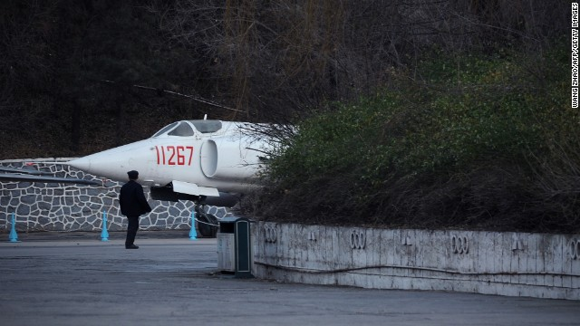 A man looks at Chinese aircraft on display during a visit to a museum in Beijing on November 29.