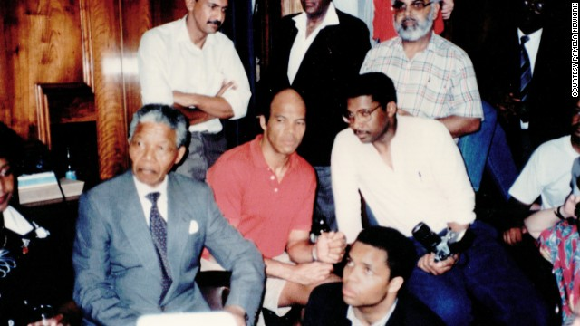 Author Sylvester Monroe, with glasses, meets with Nelson Mandela in Cape Town, South Africa, in 1990.