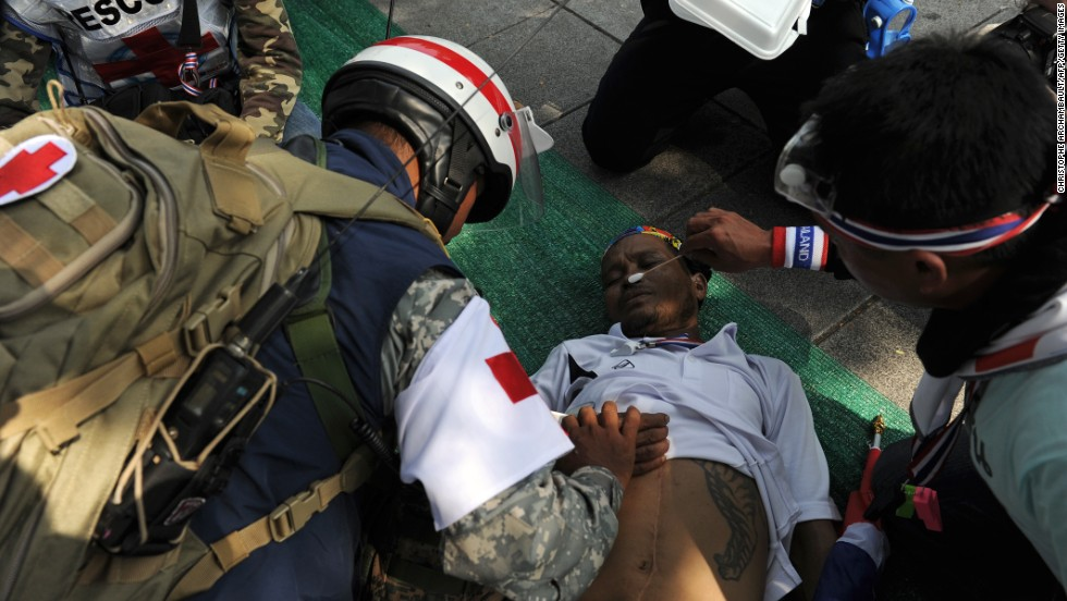Rescuers treat a Thai anti-government protester after he fainted from exhaustion during a rally outside Government House in Bangkok on December 9.