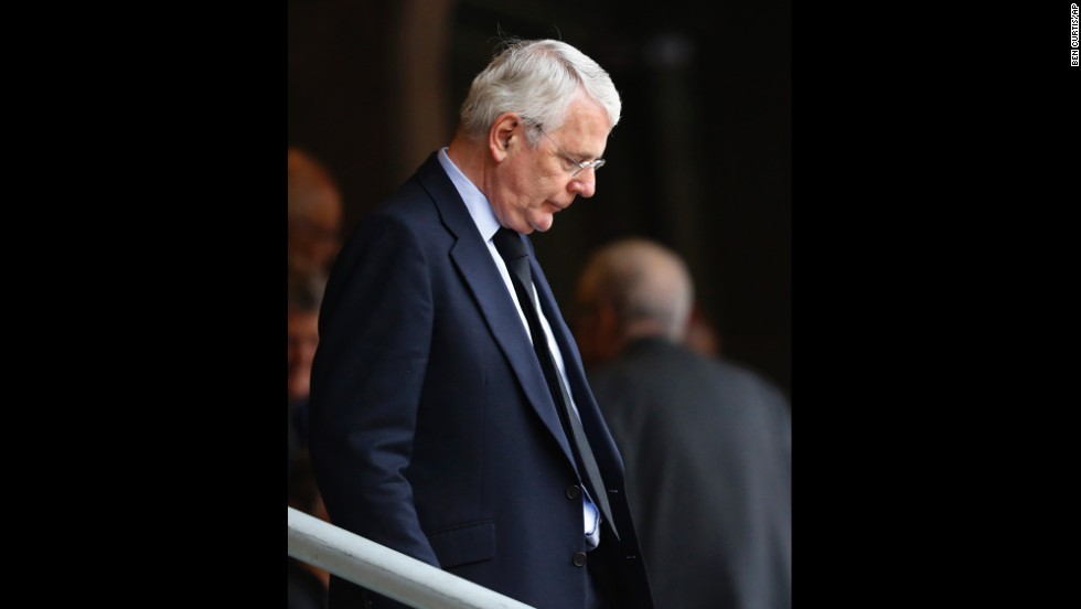 Former British Prime Minister John Major arrives for the memorial service.