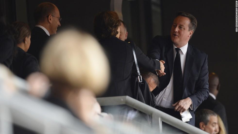 British Prime Minister David Cameron arrives for the memorial service.