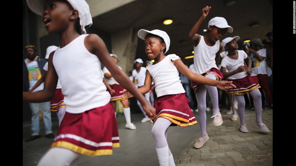 Girls dance during the memorial service at FNB stadium.