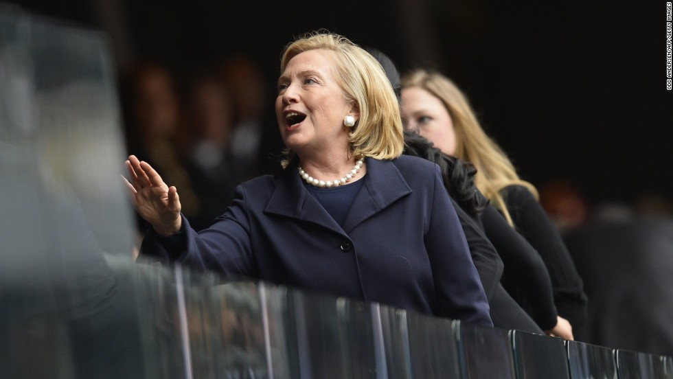 Former Secretary of State Hillary Clinton arrives for the memorial service.