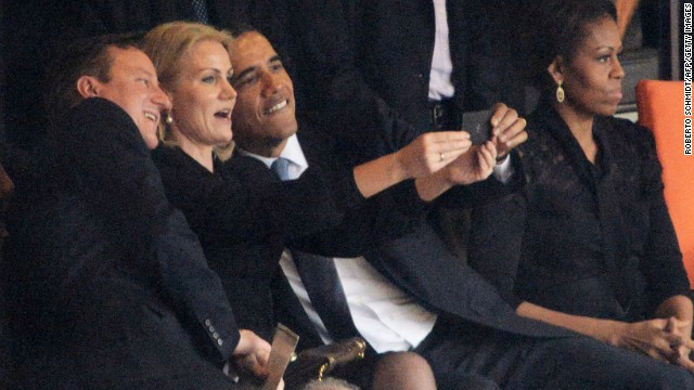 Obama snaps 'selfie' at Mandela memorial