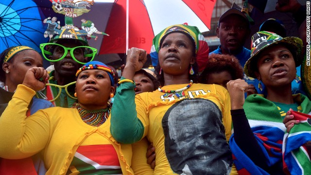People attend the memorial service for late South-African president Nelson Mandela , on December 10, 2013 at Soccer City Stadium in Johannesburg. Mandela, the revered icon of the anti-apartheid struggle in South Africa and one of the towering political figures of the 20th century, died in Johannesburg on December 5 at age 95. Mandela, who was elected South Africa's first black president after spending nearly three decades in prison, had been receiving treatment for a lung infection at his Johannesburg home since September, after three months in hospital in a critical state.