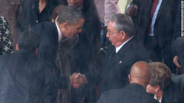 U.S. President Barack Obama shakes hands with Cuban President Raul Castro during the official memorial service for former South African President Nelson Mandela on December 10 in Johannesburg, South Africa.