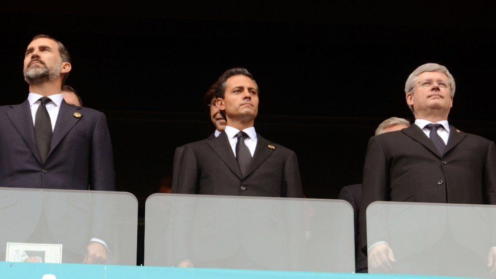 This handout photo released by Mexican presidency press office shows (L-R) Spanish Prince Felipe de Borbon, Mexican President Enrique Pena Nieto an Canadian Prime Minister Stephen Harper on December 10, 2013, while attending the funeral of Nelson Mandela at Soccer City stadium in Johannesburg, South Africa. AFP PHOTO/ MEXICAN PRESIDENCYHO/AFP/Getty Images