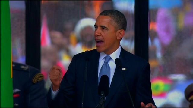 Obama pays homage to Mandela