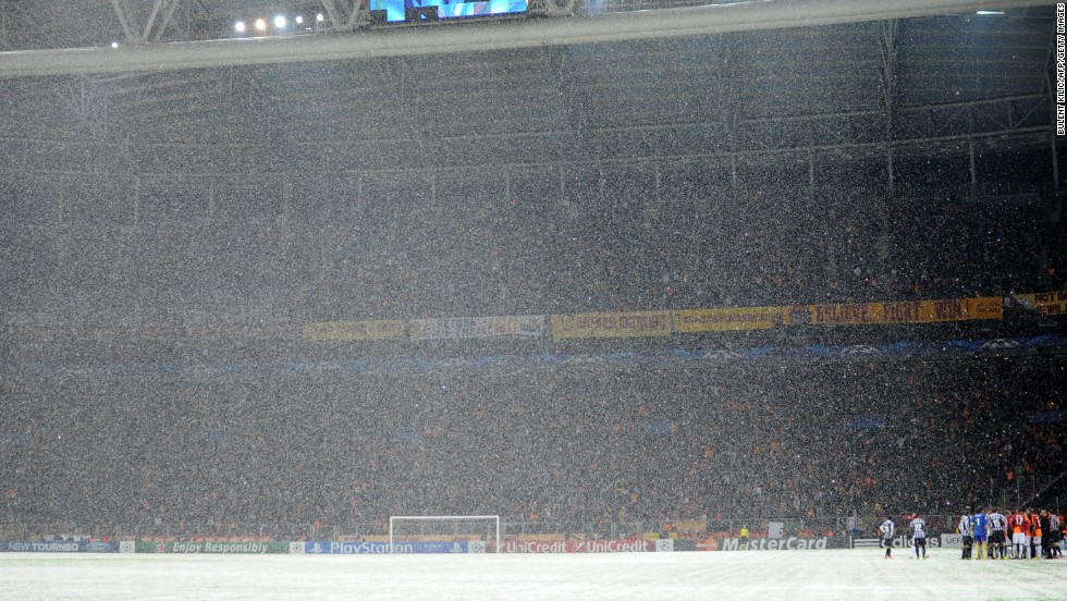 Snow teaming down at the Turk Telekom Arena in Istanbul on Tuesday night. Despite the best efforts of ground staff to make the pitch playable, the game was eventually abandoned. UEFA say the match will resume at 12pm GMT on Wednesday.