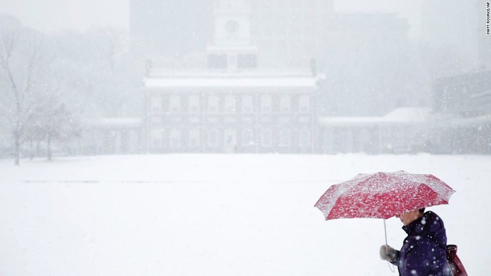 A woman walks past Independence Hall during a snowstorm in Philadelphia on December 10.