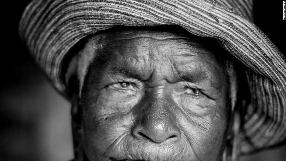 "Photographer George Kanyingi said: ""Many times we have sat down around a fire and this lady had told us stories of how things were before, during and after independence. Her stories of how much things used to cost really intrigued us and I just wish she had a camera those days to capture all of it."""