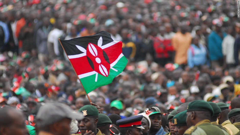 "Boniface Mwangi said this photo showed: ""The Kenyan flag flying high during the promulgation of the Kenyan Constitution on August 26th 2010. It was a historic ceremony, thousands of Kenyan's gathered to witness the establishment of a new constitution."""