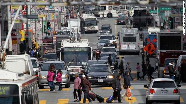 Cars and buses share the road along Stockton Street in San Francisco.