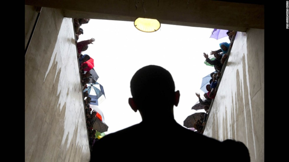 South Africans cheer as President Obama waits in a tunnel before speaking at the memorial service.