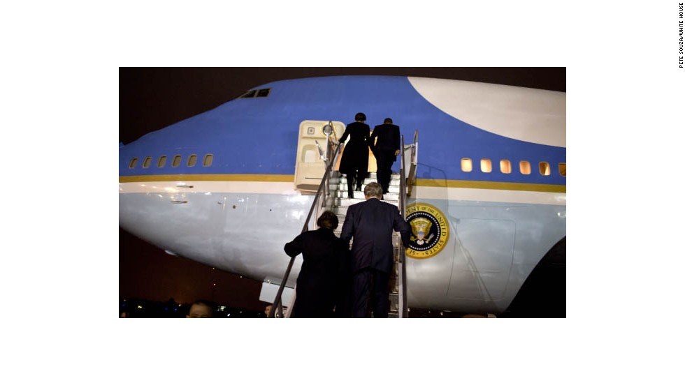 The Bushes and Obamas board Air Force One in Johannesburg.