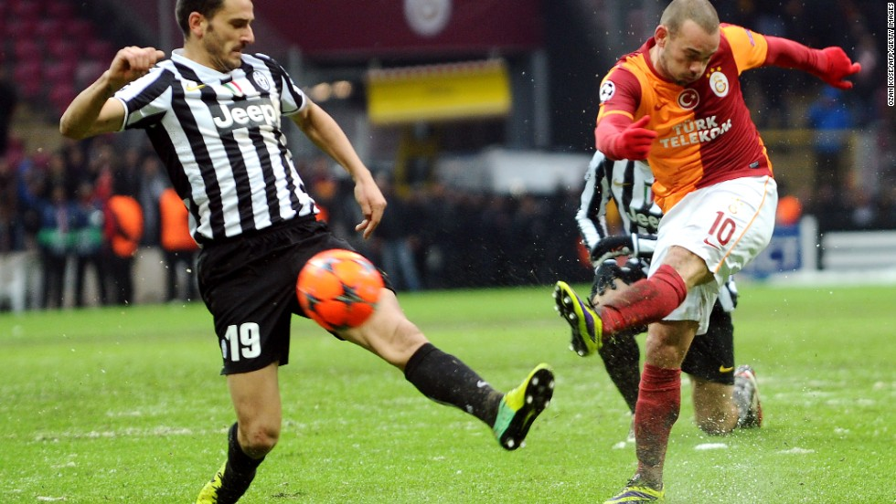 Dutch forward Wesley Sneijder (right) scored a late goal for Galatasaray against Juventus in Istanbul. Victory for the Turkish champions means they and not the Italian league leaders go through to the last 16. The game which started on Tuesday, but was halted after 32 minutes because of a snowstorm, played to a conclusion on Wednesday.