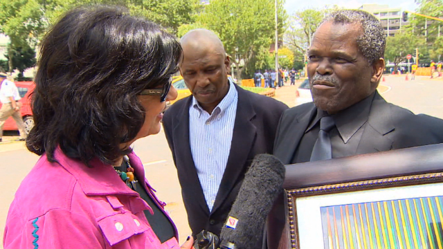 CNN's Christiane Amanpour speaks to South Africans about Nelson Mandela in Pretoria on December 11, 2013.