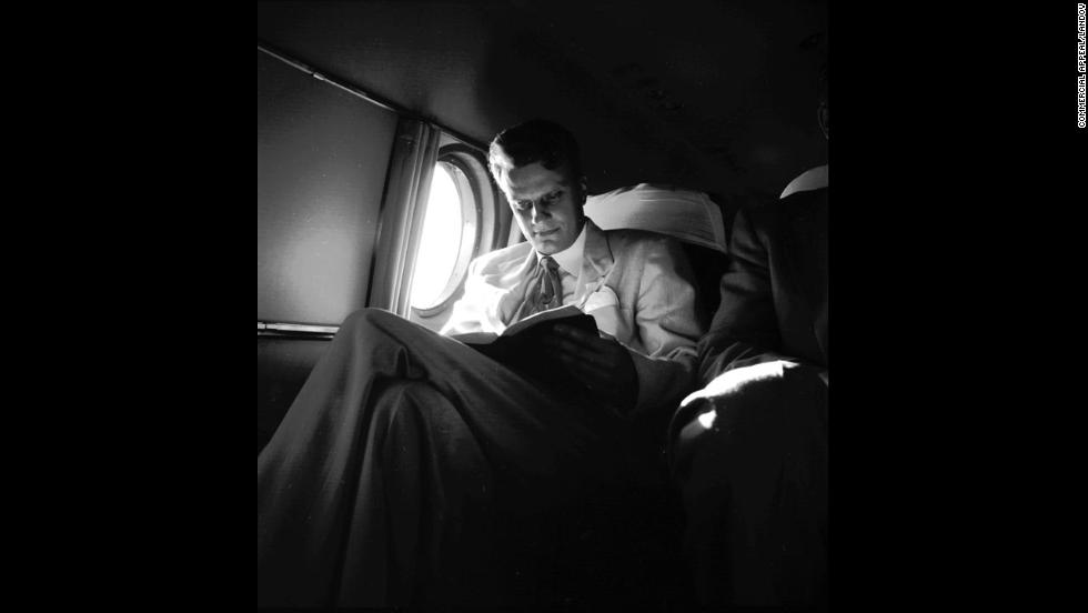 "Graham reads on an airplane during a ""Pulpit in the Sky"" trip on January 15, 1953."