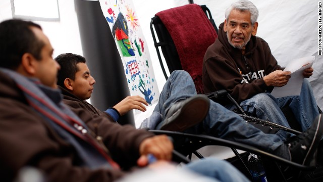 Eliseo Medina, right, who was fasting in support of immigration reform with  Fast for Families, talks with fellow fasters on December 2