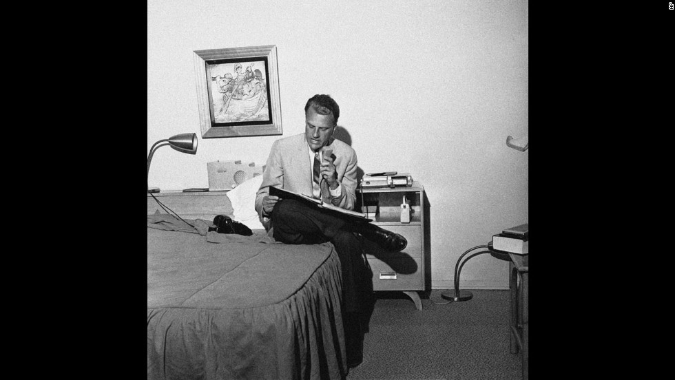 Graham dictates a synopsis of his evening sermon into a tape recorder in Fresno, California, on July 18, 1962. Secretaries would then type the synopsis for distribution to the press. Graham was conducting an eight-day crusade in Fresno.