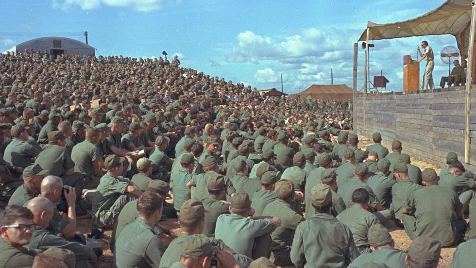 Graham speaks to more than 5,000 U.S. troops at Long Binh, Vietnam, on December 23, 1966.