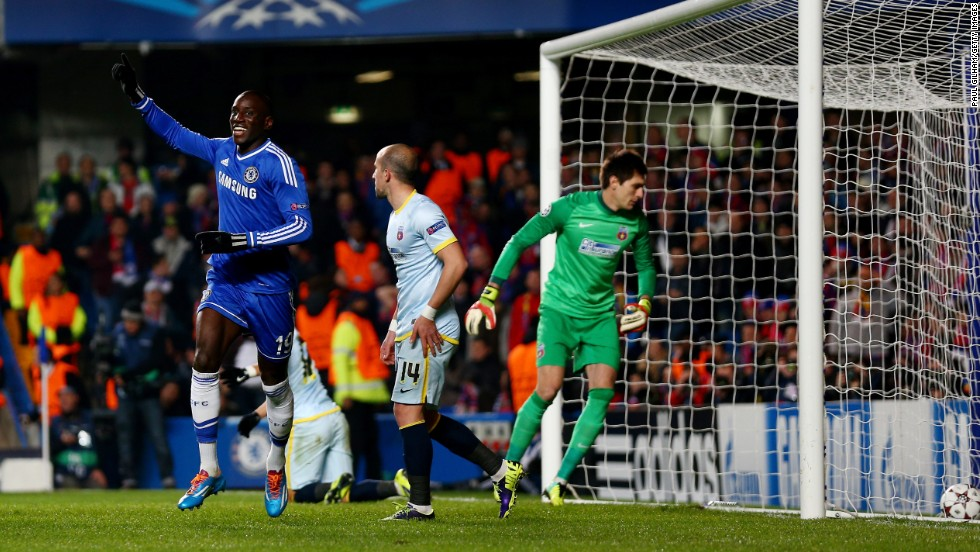 Dembe Ba (left) celebrates Chelsea's opening goal against Steaua Bucharest at Stamford Bridge on Wednesday. Chelsea's 1-0 win against the Romanian champions ensured they finished Group E as winners.