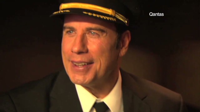 spc business traveller john travolta flying planes_00015117.jpg