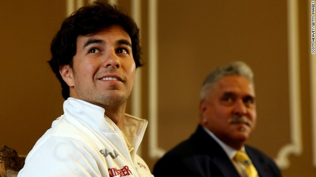 All smiles for Mexican racer Sergio Perez as he signs for Force India under the watchful eye of new boss Vijay Mallya