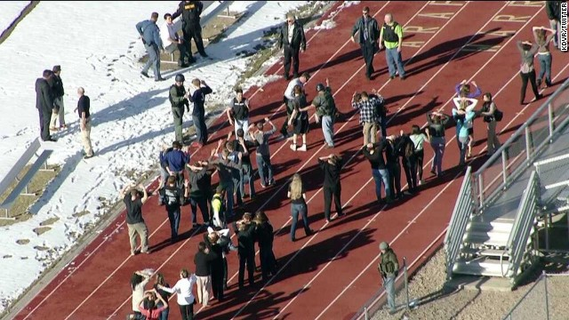 Students from Arapahoe High Scool gather outside the school after being evacuated in Centennial, Colorado, on December 13.