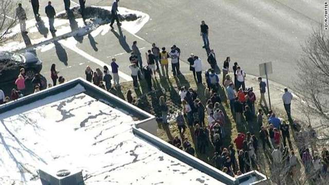 People gather outside the Arapahoe Highschool in Centennial, Colorado, on December 13.