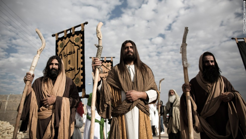 "An Iranian Muslim Shiite man, acting as Jesus, center, takes part in the annual religious performance of ""Taazieh"" in the Iranian town of Noosh Abad on November 12, 2013."