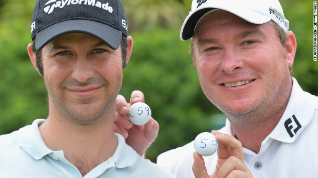 Jorge Campillo of Spain (left) and South Africa's Colin Nel signal their rounds of 59 at the Nelson Mandela Championship.