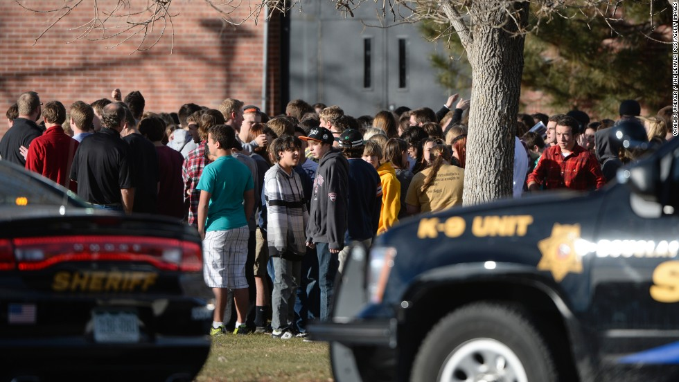 Students wait outside Arapahoe High school after being evacuated on December 13.