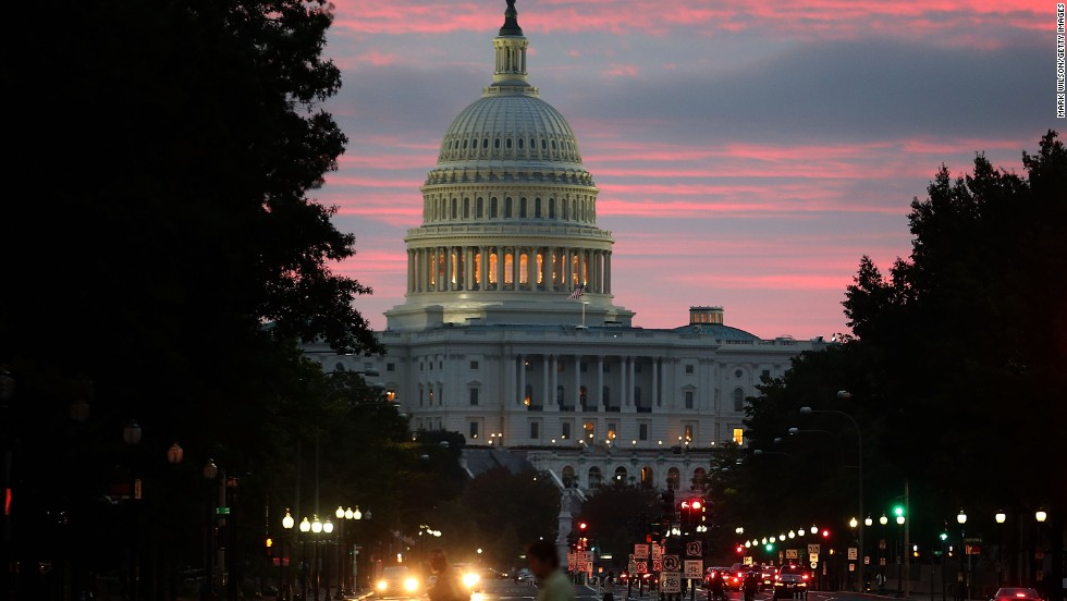 WASHINGTON, DC - OCTOBER 17: The sun begins to rise behind the U.S. Capitol building on the morning after a bipartisan bill was passed by the House and the Senate to reopened the government and raise the debt limit, on October 17, 2013 in Washington, DC. President Obama signed the bill into law, that will fund the government until January 15, 2014 and allow the government to pay bills until February 7, 2014.