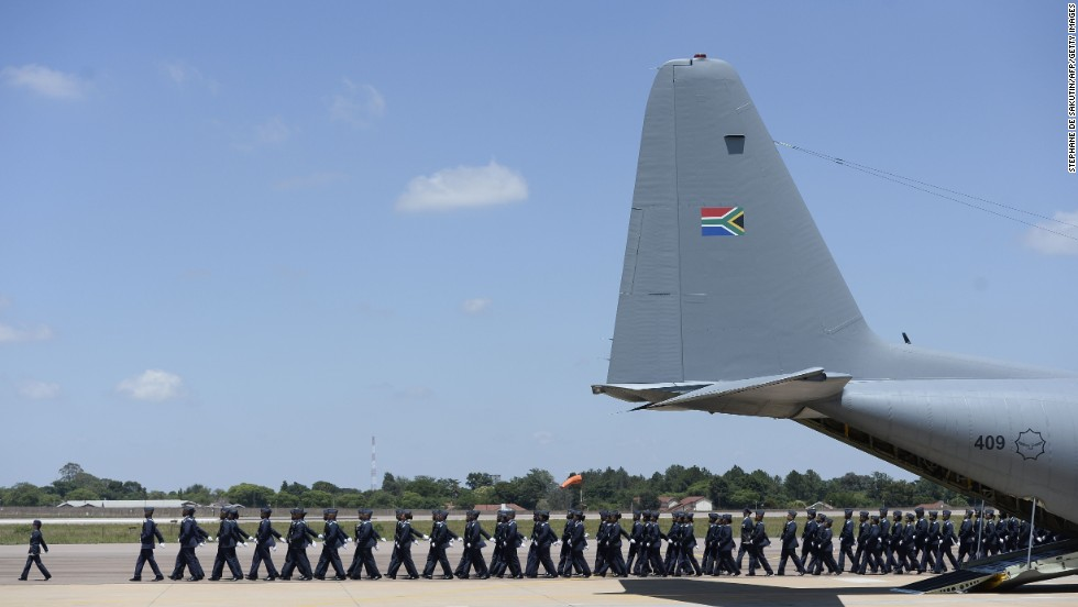 Troops march near the plane that transported Mandela's remains to the village of Qunu for a state funeral on Sunday.
