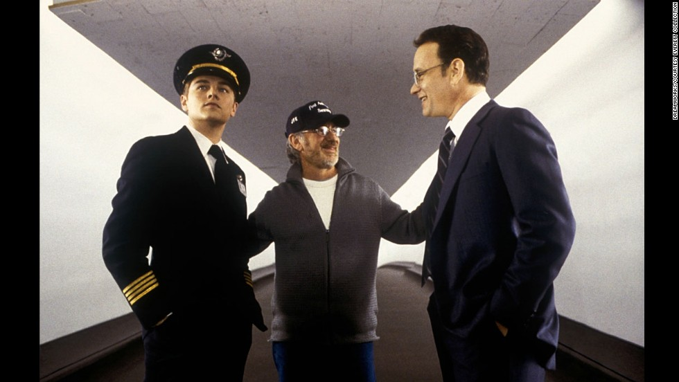 "Spielberg, center, works with actors Leonardo DiCaprio, left, and Hanks on the set of ""Catch Me if you Can"" in 2002."