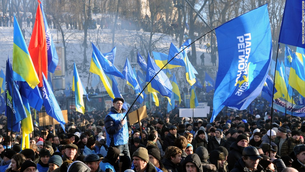 Supporters of the president wave flags of the ruling Party of Regions, as well as Ukrainian flags, during a rally on Kiev's European Square on December 14.