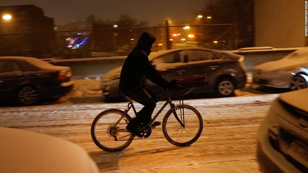 A person delivers food on a bike during a snowstorm in Brooklyn, New York, on December 14.