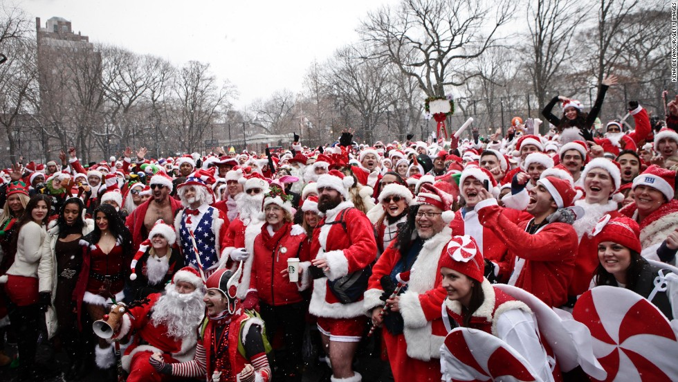 Revelers dressed as Santa Claus pose for a picture at Tompkins Square Park during the annual NYC SantaCon on Saturday, December 14, 2013.