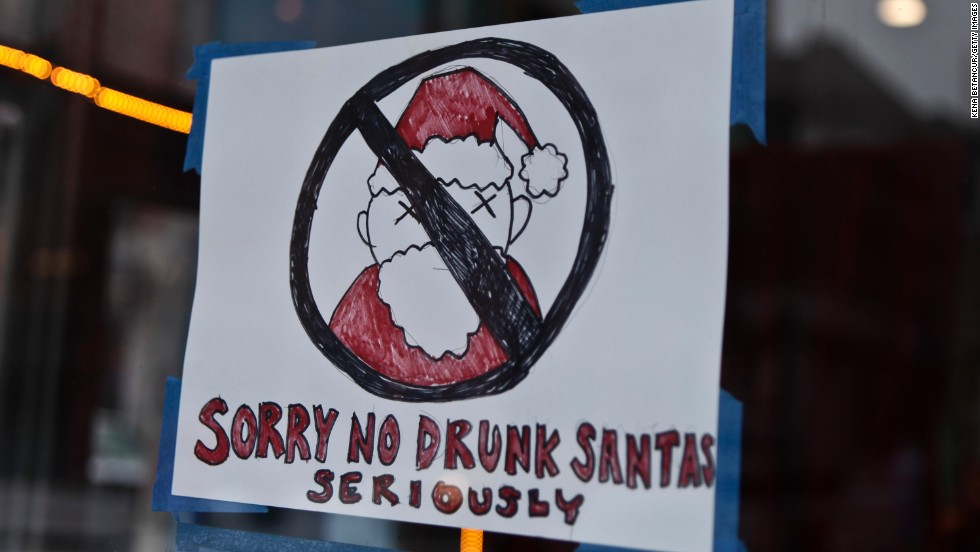 "A poster banning SantaCon participants is displayed outside a restaurant in the Lower East Side. Some community groups have established a ""Santa-Free"" zone that urges bars not to serve alcoholic beverages to people participating in order to dissuade incidents of public vomiting and urination in the streets."