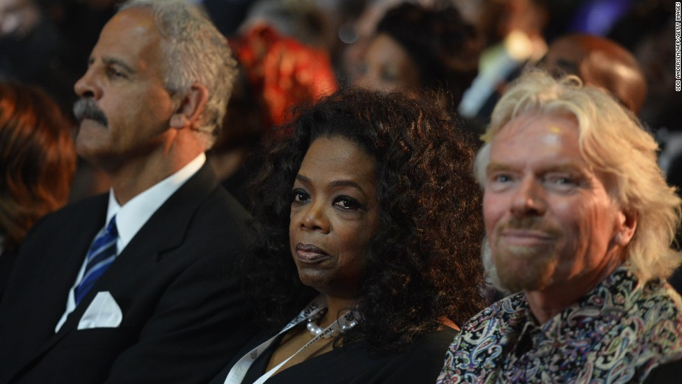 Oprah Winfrey and Richard Branson attend the funeral ceremony.