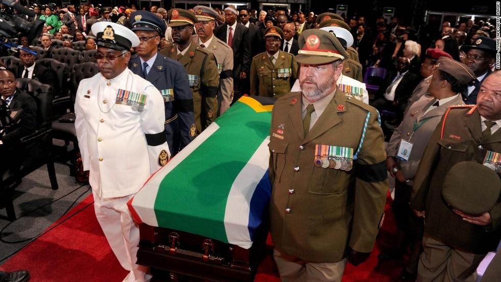 Mandela's casket is escorted inside for the funeral ceremony.