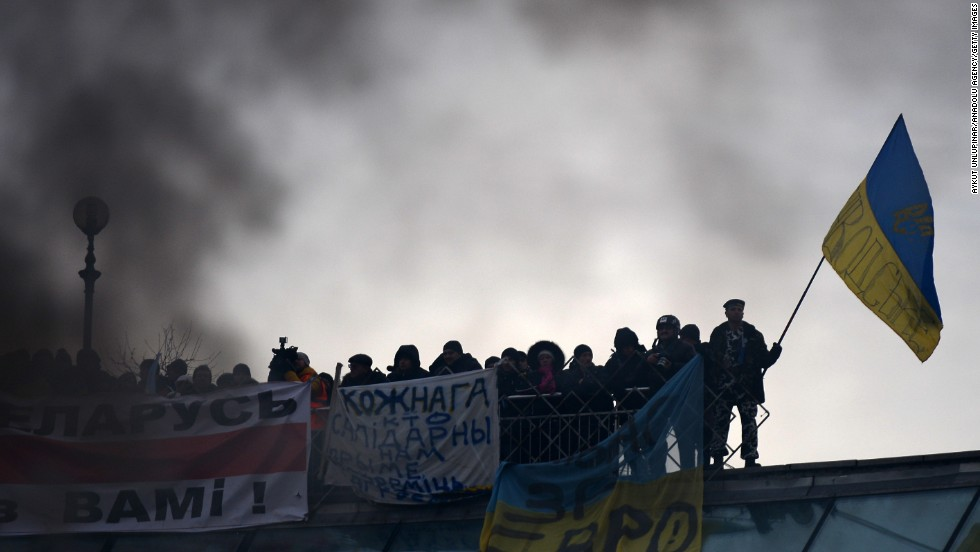 Smoke rises as Ukrainian protesters continue their anti-government demonstrations in Independence Square on December 15.
