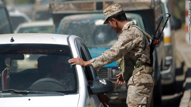 A Yemeni soldier mans a checkpoint in the capital on December 15 after a Japanese diplomat was stabbed in a kidnap attempt.