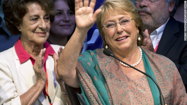 Chilean president-elect, Michelle Bachelet, waves as she celebrates after getting the results of the run-off presidential election in Santiago on December 15, 2013. Socialist Michelle Bachelet was swept back into office Sunday as Chile's next president, on a platform of boosting education and narrowing the gap between rich and poor. AFP PHOTO/MARTIN BERNETTI (Photo credit should read MARTIN BERNETTI/AFP/Getty Images)