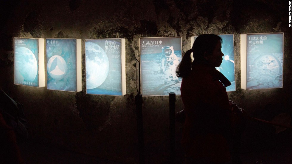 "DECEMBER 16 - BEIJING, CHINA: A woman browses an exhibit about the moon at the China Science and Technology Museum in Beijing. <a href=""http://edition.cnn.com/2013/12/14/world/asia/china-moon-landing/index.html?hpt=hp_c4"">China's first moon rover touched down on Saturday</a>. The Jade Rabbit (called Yutu in Chinese) left deep traces on the lunar surface, as China became the third country in history to reach the moon."