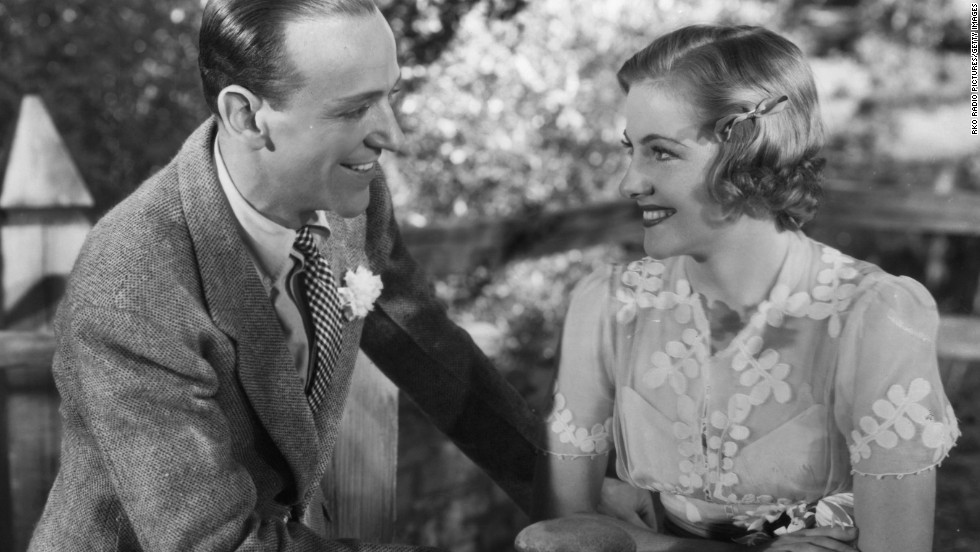 "Fontaine and Fred Astaire appear in a scene from the film ""Damsel In Distress"" in 1937."