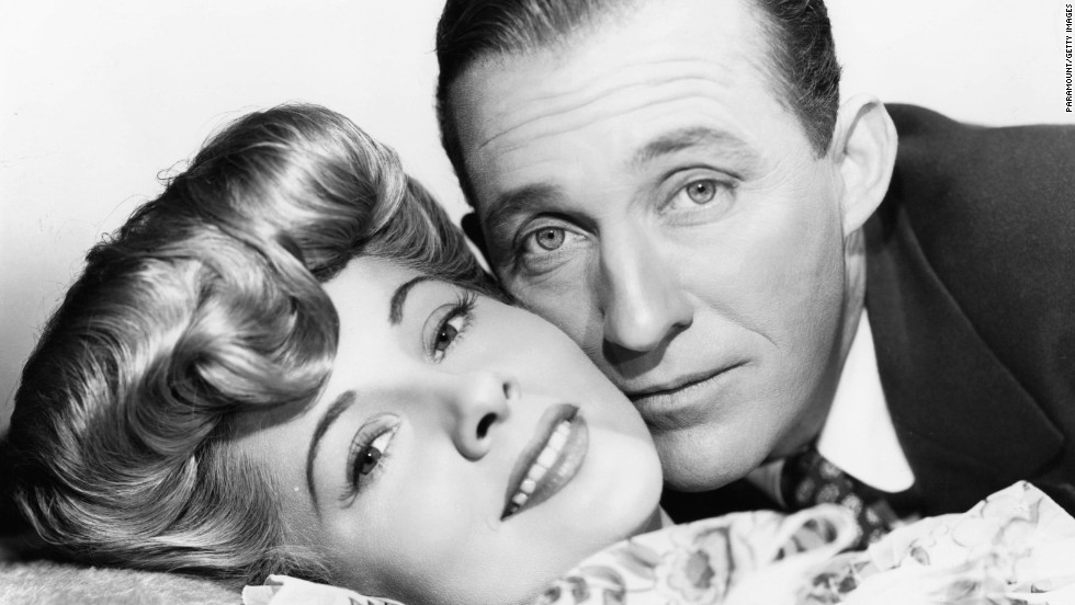 "Fontaine and Bing Crosby, cheek to cheek in a scene from the film ""The Emperor Waltz"" in 1948."
